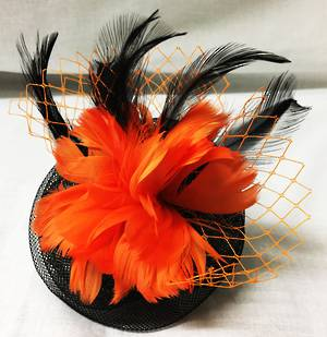 Orange and black circular fascinator with feather flower detail