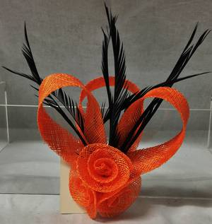 Orange rosette and loop fascinator with black feathers
