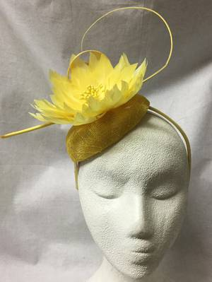 Yellow fascinator with spikey feather flower