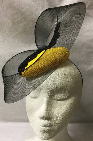 Yellow pillbox with black lace and sinamay band